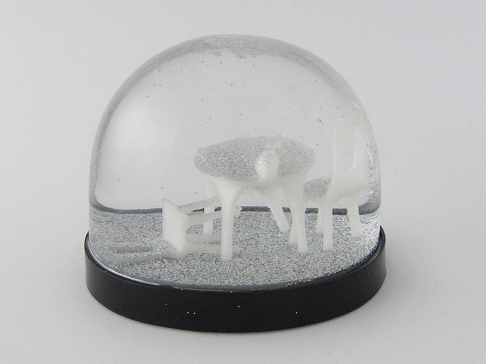 Schneekugel mit Seance